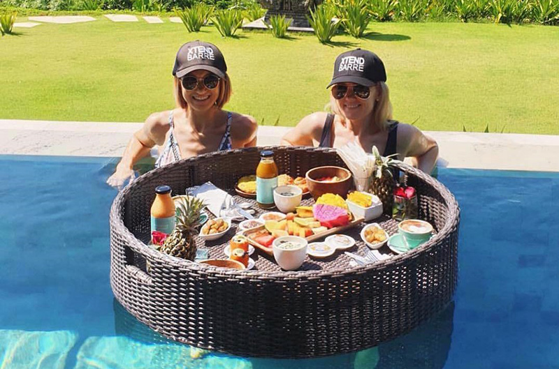 Women eating breakfast in the pool