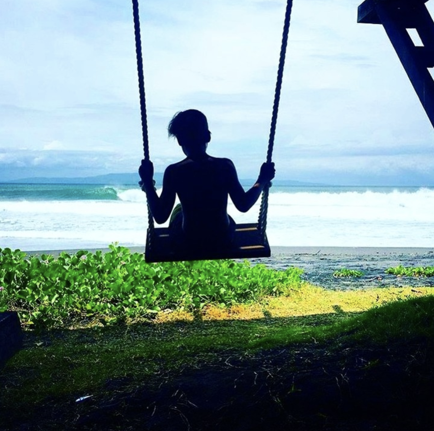 kid on a swing in Bali