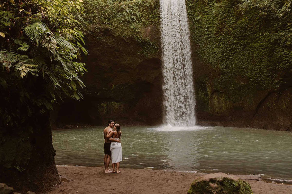 Couple in front of a waterfall in Bali
