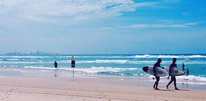 Kirra beach with blue ocean water, waves coming in.